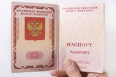 Russian Traveling Passport in hand. — Stock Photo