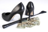Black Leather Flogging Whip, high heels shoes and money — Stock Photo