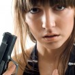 Beautiful girl with gun — Stock Photo