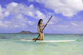 Brunette in bikini on her stand up paddle board — Stock Photo