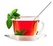 Cup of fragrant tea with fresh leaves of green tea isolated — Stock Photo
