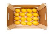 Box with ripe lemons — Stock Photo