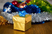 Box with a gift for a holiday — Stock Photo
