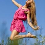 Happy woman dancing in nature — Stock Photo