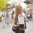 Young Business Woman with tablet computer walking in public spac — Stock Photo