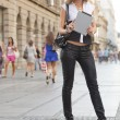 Young Business Woman with tablet computer walking on urban stree — Stock Photo
