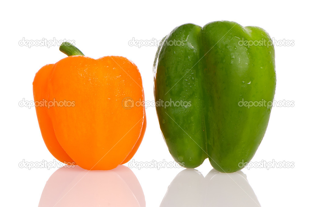 Two fresh peppers on white background.  Lizenzfreies Foto #6946850