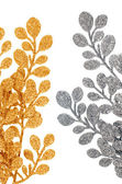 Christmas decorative golden and silver leaves — Stock Photo