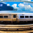 Commuter Train and Building — Stock Photo