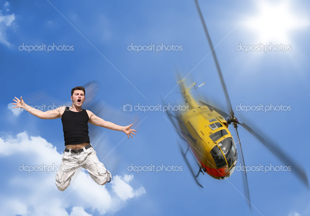 A boy jumps without a parachute from a helicopter — Stock Photo #7232398