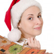 Girl in the hat of Santa Claus - Stok fotoraf