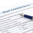 Survey form and pen - Stock Photo