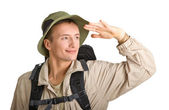 Young man dressed in a tourist — Stock Photo