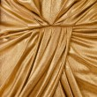 Folds gold fabric closeup - Stock Photo
