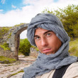 Tourist hiding his head under a shawl - Stock Photo