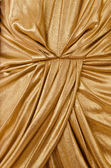 Складки Золотая ткань крупным планом — Стоковое фото