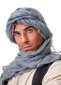 Tourist hiding his head under a shawl — Stock Photo