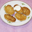 Appetizing baked fritters — Stock Photo