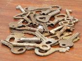 Dużo metalowe klucze zbliżenie. — Zdjęcie stockowe