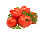Fresh red tomatoes and green parsley branch. — Stock Photo
