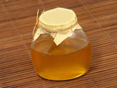 Honey jar. — Stock Photo