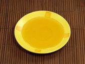 Honey in yellow plate. — Stock Photo