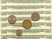 USA dollar banknotes and coins. — Stock Photo