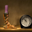 Candle and alarm clock. — Stock Photo