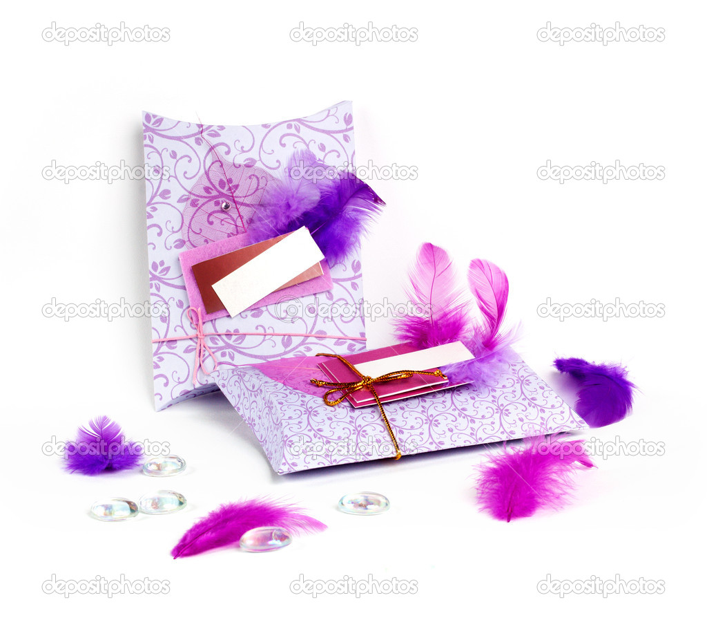 Two beautiful present envelopes decorated with feathers — Stock Photo #7134375