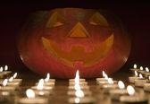 Creepy pumpkin near candle, halloween concept — Stock Photo