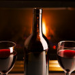 Wine and fireplace — Stock Photo
