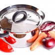 Stainless steel cooking pot and vegetables isolated on white — Stock Photo