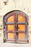 Closed old wooden gate in caponier — Stock Photo