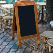 Stock Photo: Paris street view of Restaurant's terrace with blackboard