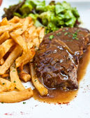 Steak beef meat with tomato and french fries — Stock Photo