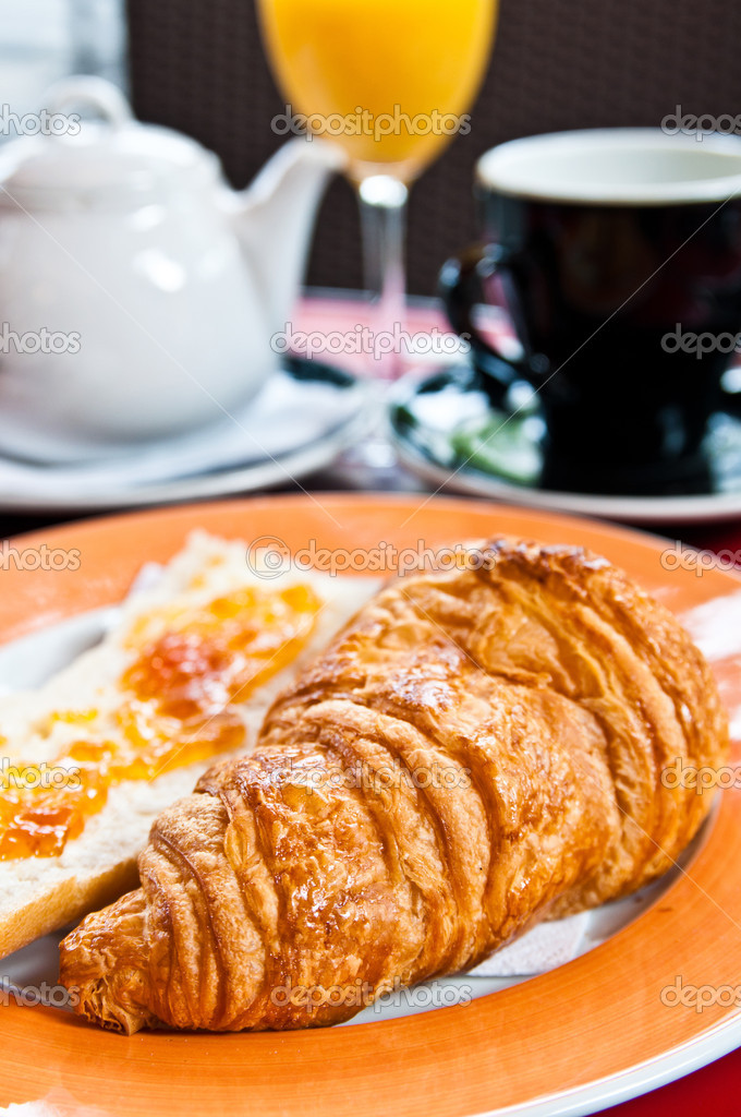 Breakfast with coffee and croissants on table  Stock Photo #6792259
