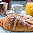 Breakfast with coffee and croissants on table — Stock Photo