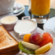 Breakfast with orange juice and fresh fruits — Stock Photo