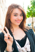 Outdoor portrait of smiling charming young woman — Stock Photo