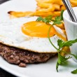 Classical english breakfast with egg and fries — Stock Photo