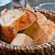 Stock Photo: Bread in basket - little roll breads in basket on table