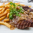 Juicy steak veal - beef meat with potatoes — Stock Photo