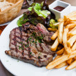 Stock Photo: Juicy steak beef meat with tomato and french fries