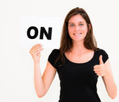 Happy portrait young woman with board ON — Stock Photo
