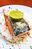Grilled salmon and lemon - french cuisine dish with tomato and s — Stock Photo