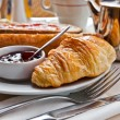 Breakfast with coffee and croissants in a basket on table — Stock Photo #6978577