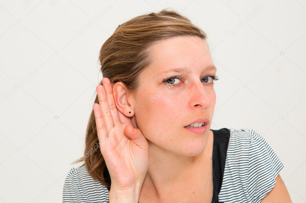 Relying on hand-ear listening young woman — Stock Photo #6992404