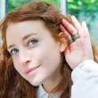 Relying on hand-ear listening the Good news — Stock Photo #7119133