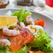 Fresh seafood salad with smoked salmon - Stock Photo
