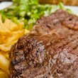 Juicy steak beef meat with tomato and french fries — Stock Photo